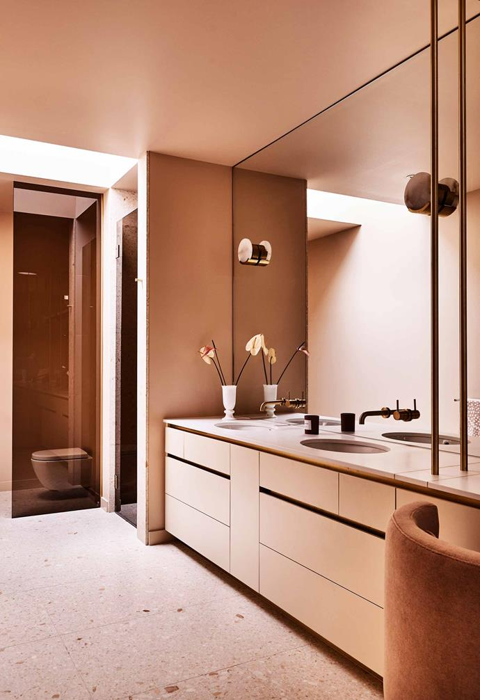 **Bright idea** Continue your design theme in functional zones, too. Here, the mid-century vibe features in the bathroom by way of the smoky glass shower screen, nude-pink colour palette and vintage-look light fittings.