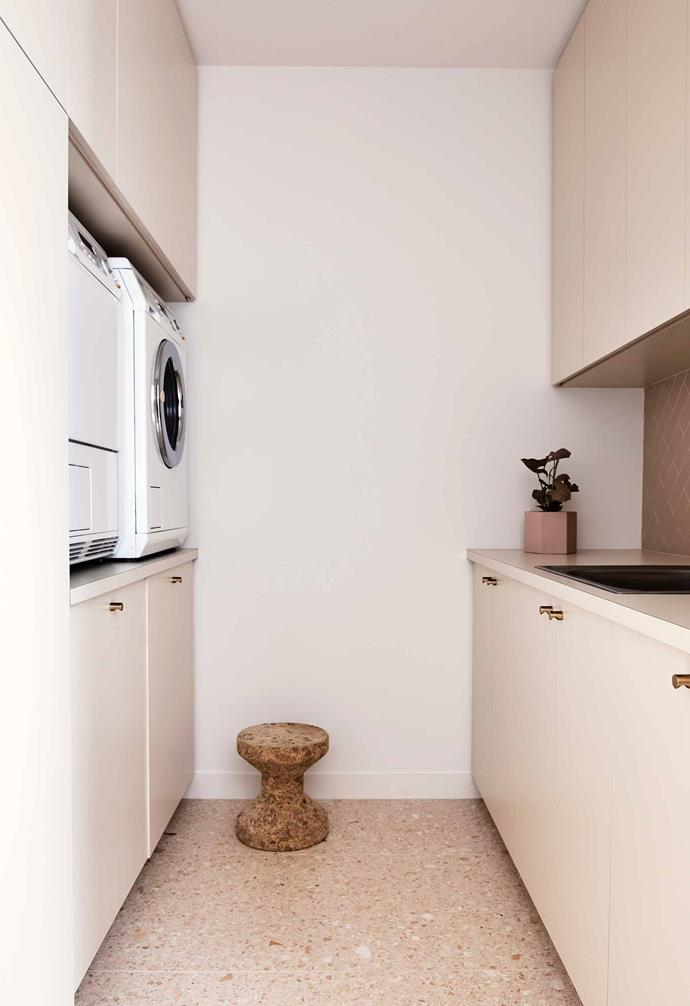 "**Laundry** The same terrazzo tiles from the ensuite continue in the laundry, while Inax tiles from [Artedomus](https://www.artedomus.com/|target=""_blank""