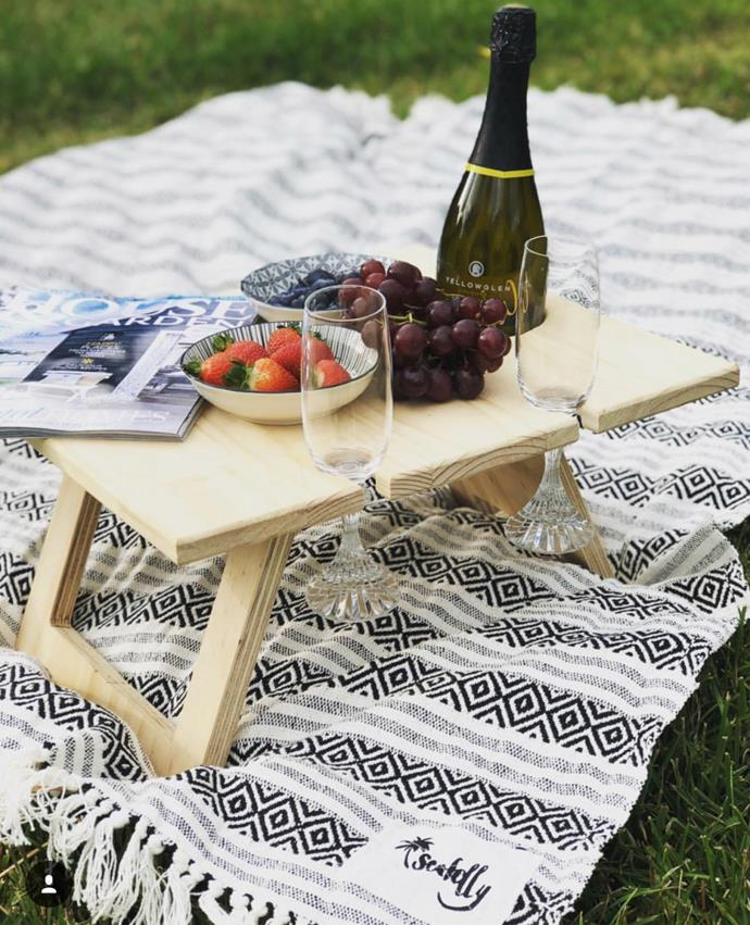 "Indi Tribe Collective [folding wine table](https://www.thefinderskeepersmarketplace.com/shop-directory/indi-tribe-collective/products/folding-wine-table-4-glass-pine|target=""_blank""