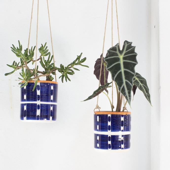 "Trade the Mark [Vertical Tracks hanging planter](https://www.thefinderskeepersmarketplace.com/shop-directory/trade-the-mark/products/vertical-tracks-hanging-planter|target=""_blank""|rel=""nofollow""), $75"