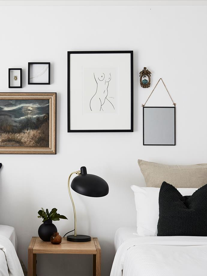 "**Monochrome dreams** Black accents will give a [coastal style interior](https://www.homestolove.com.au/coastal-decorating-ideas-for-the-home-4160|target=""_blank"") a contemporary feel. Here, black frames mirror the dark cushions and lamp to create a cohesive, monochrome scheme. Vintage finds and one-off art pieces pair beautifully with sumptuous linens."