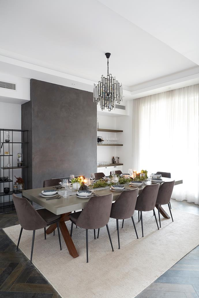 """**Tess and Luke's Formal Living Room (After)** <br> From the 10-seater concrete dining table to the tabletop styling, the judges loved everything about the fabulous formal dining room Tess and Luke delivered. """"This house had the weakest formal lounge room but now it really makes a big statement,"""" said Neale."""