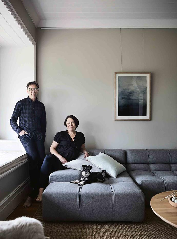 Tracie and her husband David with mini Schnauzer Albert on their B&B Italia 'Tufty-Time' sofa. The cushions and jute rug are AURA by Tracie Ellis and the print is Blue Waters by Trine Holbaek.