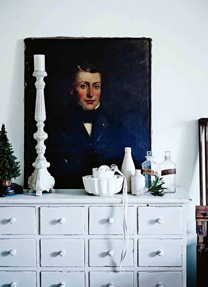 An early colonial portrait, artist unknown, rests on a spice cabinet painted with Dulux Barnfloor, with a candlestick from Vintage Rose.