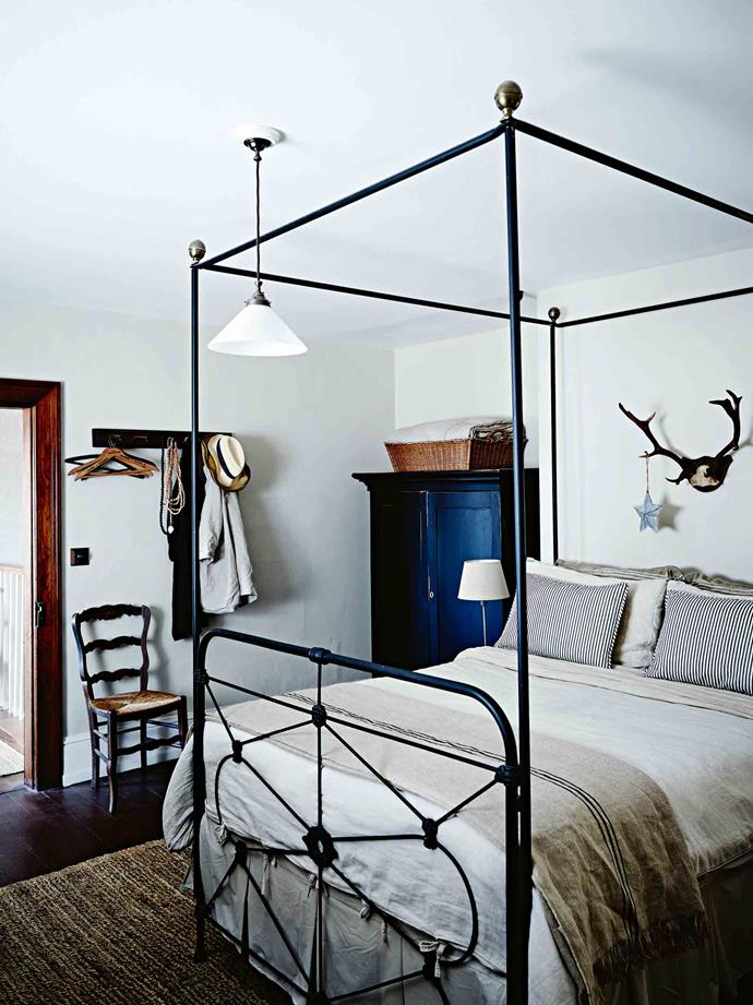 """A star overlooks a bed rescued from the local tip, now graced with linen by [Aura by Tracie Ellis](https://fave.co/2YxXyId