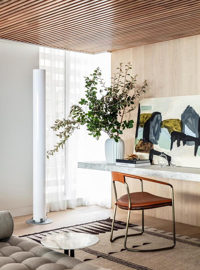 Brass sculptures from Hub and vase from Rudi Rocket below a Christiane Spangsberg artwork from Jerico Contemporary. Flexform daybed from Fanuli. A BassamFellows chair from Living Edge faces a Michael Cusack artwork from Olsen Gallery.
