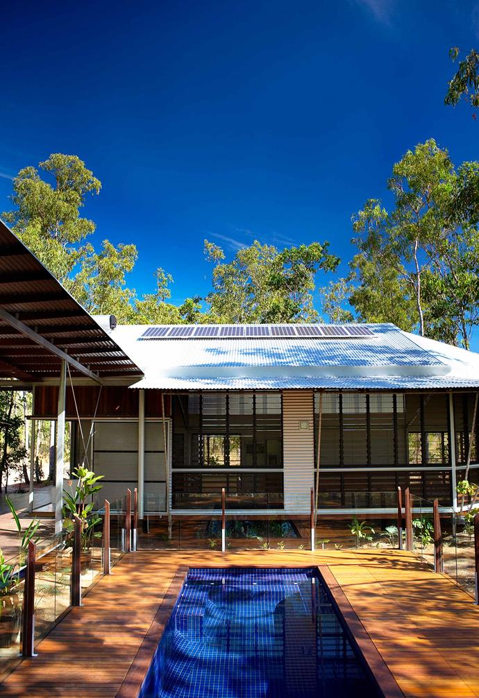 Solar panels line the roof of this family home in Darwin.