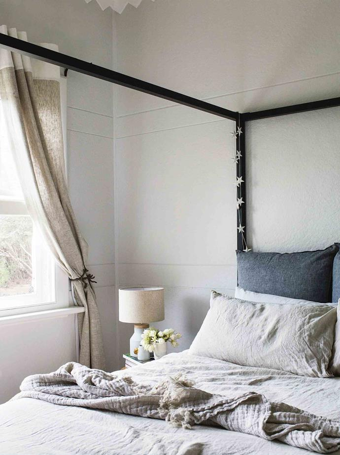 "A four-poster bed in the poolside bedroom is adorned with a 'Crush' linen throw from [Hale Mercantile Co](https://halemercantilecolinen.com/|target=""_blank""