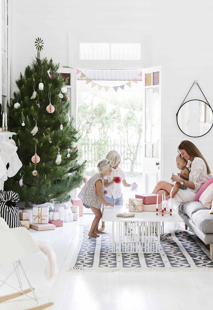 "Her family may only have lived in their home for two years, but tradition already runs deep for interior architect Lee Talbot. It comes from the childhoods of her and husband Rick; both of their families insisted on a [real tree](https://www.homestolove.com.au/how-to-care-for-your-real-christmas-tree-2616|target=""_blank"") each Christmas, and it's a custom they've continued with their own children Otis, Bertie and Rufus.<br><br>**Living area** Homeowner Lee helps her kids Bertie, Otis and Rufus with their festive decorating. A pine tree is dressed with feather clusters and a topper from [The Woodsfolk](https://www.thewoodsfolk.com.au/