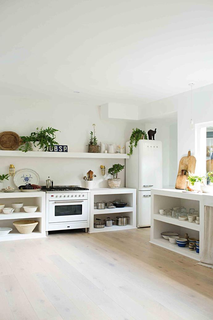 "Natural light floods into her home through large windows, including a bi-fold window in the kitchen that opens out to the garden. ""I love being able to snip fresh herbs while I'm cooking,"" says Vicki"