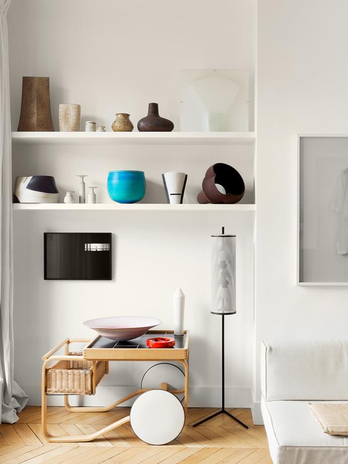 Alvar Aalto trolley under shelves with ceramics by Alev Ebüzziya Siesbye, Robert Delandre, Kristin McKirdy and others.