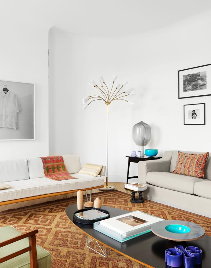 Vintage George Nelson sofa sits below a photograph by Milagros de la Torre. 'Jetlag' sofa by India Mahdavi. Floor lamp by Gino Sarfatti. 'Lighthouse' table lamp by Ronan & Erwan Bouroullec.
