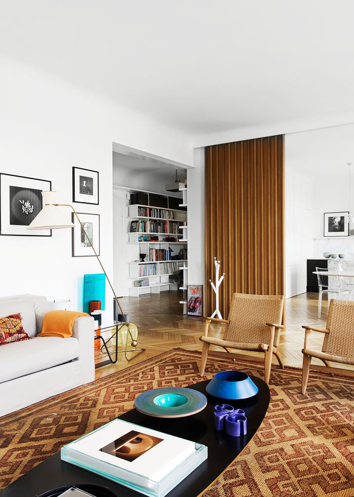 Coffee table by Charles and Ray Eames holds ceramics by Pierre Charpin and Angelo Mangiarotti. View through to the entry hall with its bookcases designed by Charlotte.