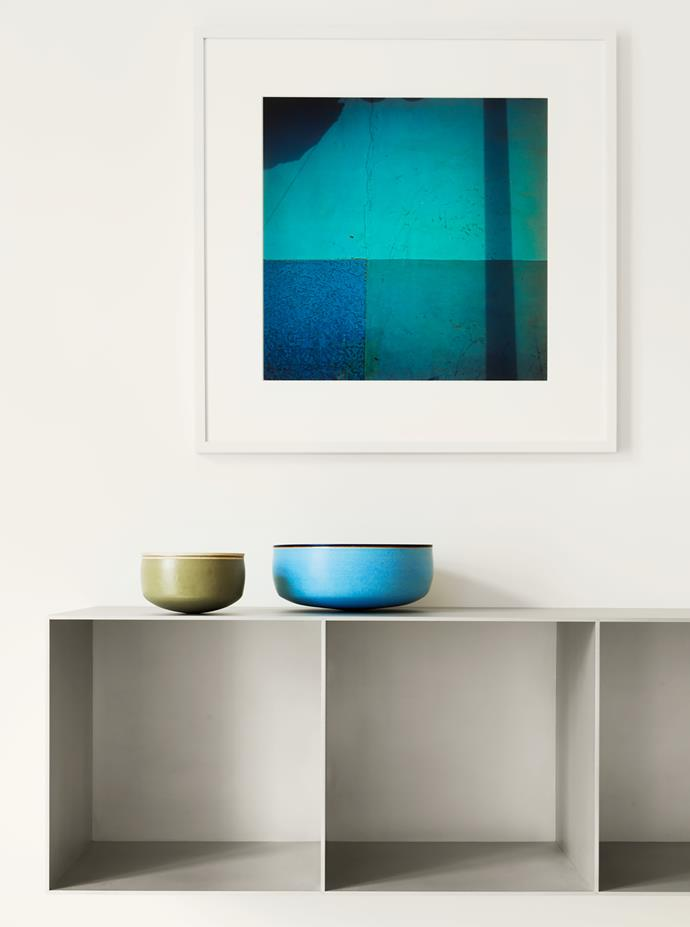 Shelves in the master bedroom designed by Maarten Van Severen hold ceramic bowls by Alev Ebüzziya Siesbye. Photograph by François Dolmetsch.