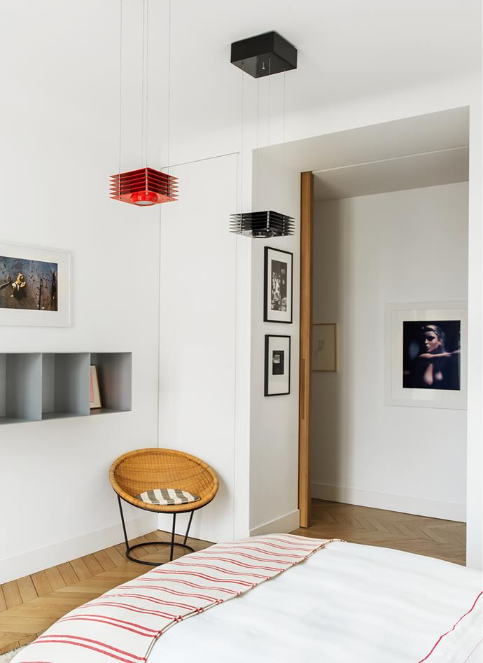 Vintage wicker chair by Joseph-André Motte. 'Hikary' ceiling lights by Ettore Sottsass. Photographs by François Dolmetsch and Miguel Rio Branco.