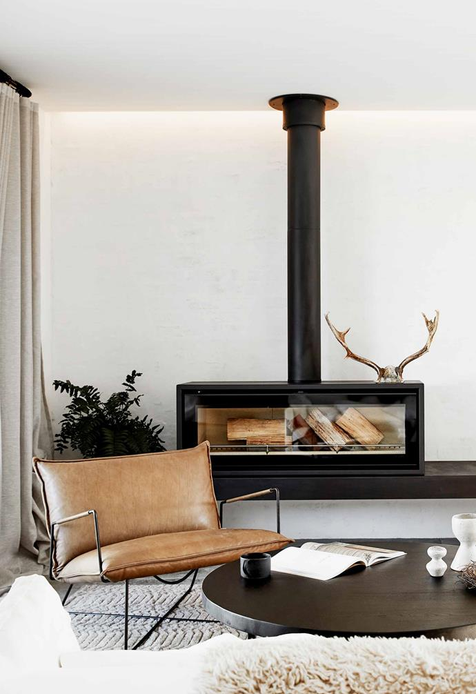 "**Living area** This inviting space draws inspiration from the family's time across the ditch, with a fireplace from [Stovax](https://www.stovax.com/|target=""_blank""