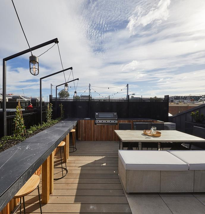 **Week 13, Rooftop terrace** In keeping with their bespoke approach to the design of their home, Jesse hand made the bench seating and bar table on their rooftop terrace. This allowed them to create a configuration to comfortably seat 20 people!
