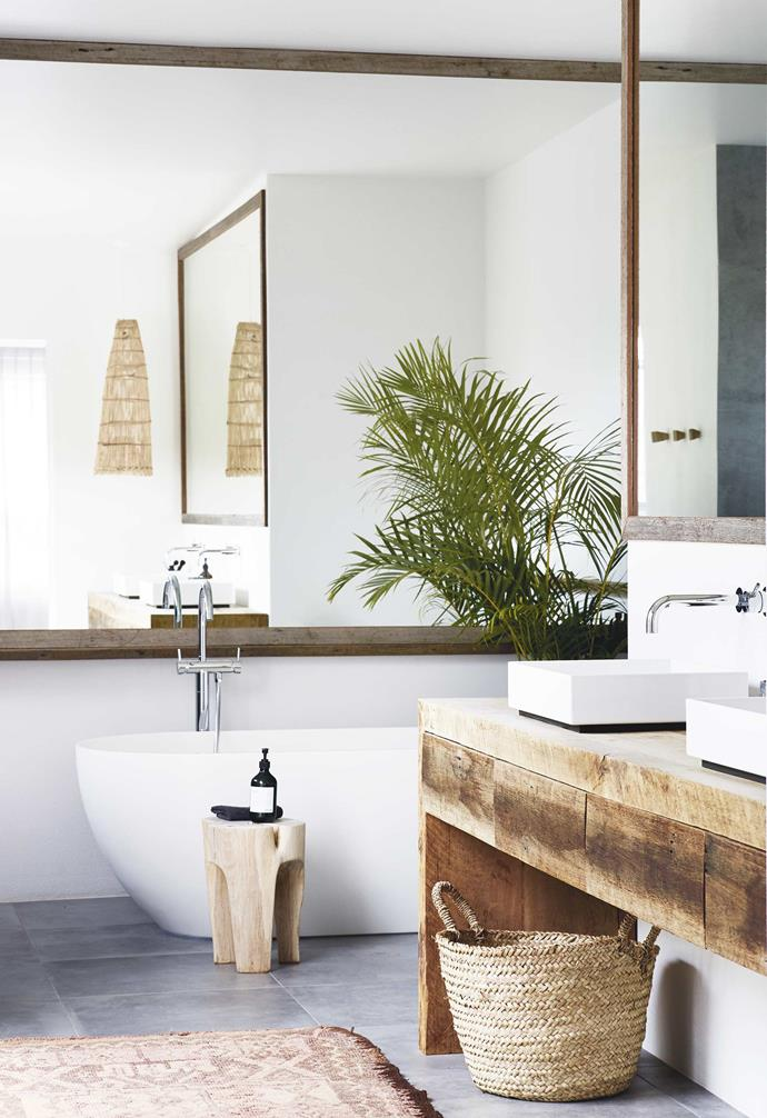 "Using recycled timber where possible was a must for the owners of this relaxed [all-white Byron Bay home](https://www.homestolove.com.au/relaxed-all-white-byron-bay-home-with-upcycled-details-19266|target=""_blank""). In the bathroom a recycled timber vanity is paired with twin white basins, white walls and a white [freestanding bath tub](https://www.homestolove.com.au/freestanding-baths-4520