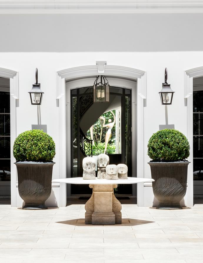 Modelled on classical French architecture, this grand Toorak home was designed by architect Russell Casper with sumptuous interiors by Thomas Hamel and Dylan Farrell. Pacific Island stone sculptures welcome in the grand entrance.