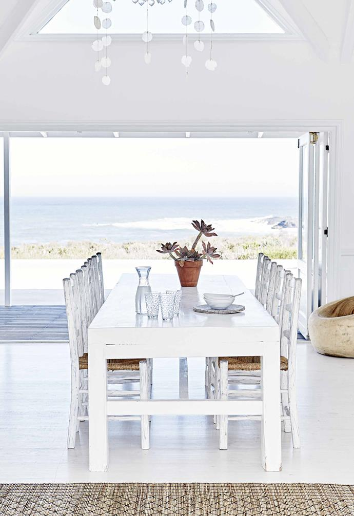 And so the couple finally found a place to realise their dream at Grotto Bay Estate, which forms part of the Cape West Coast Biosphere Reserve, where the natural beauty, biodiversity, history and culture are protected by law.<br><br>**Dining area** This space, too, was designed to make the most of the striking vista.