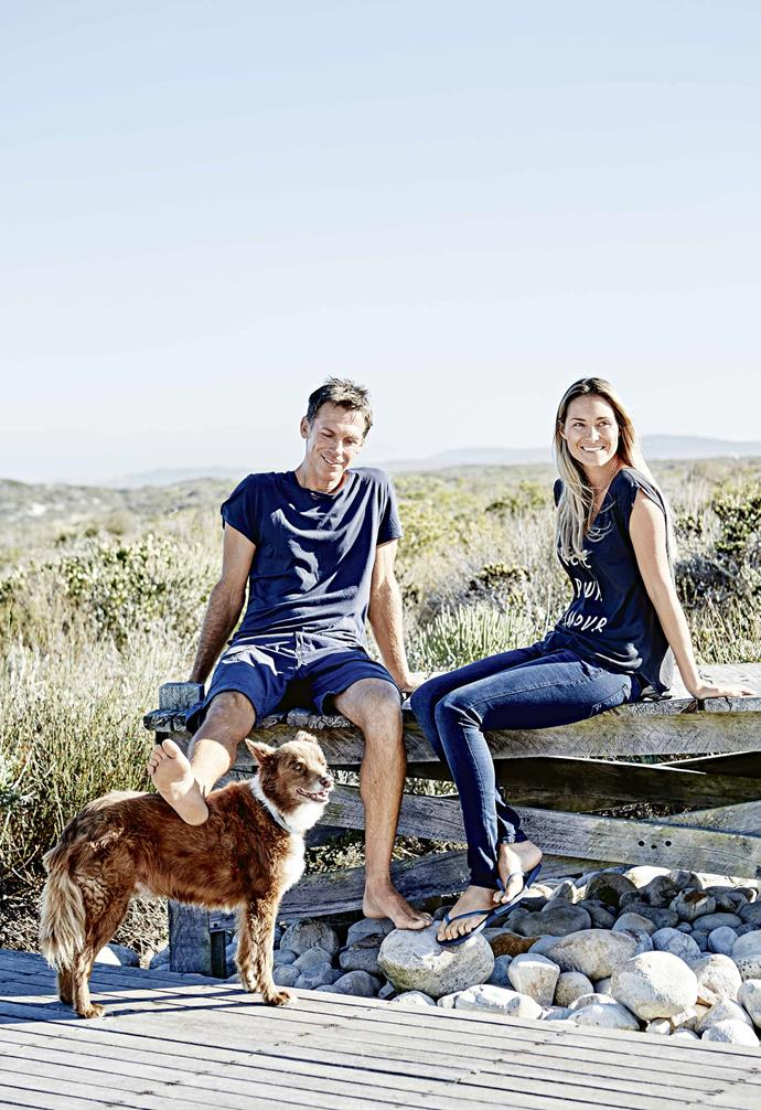 """They narrowed the hunt to another section of the west coast. """"We love it here. It's a really special place where you feel there's an adventure to be had,"""" says Rob. """"There's a wildness to it and the off-shore winds make for great surfing.""""<br><br>**Portrait** Owners Rob and Gina, pictured with Amstil the dog, were able to create a home that not only ticked off all the points on their wishlist but also paid respect to the beachy location, while leaving nautical clichés at the door."""