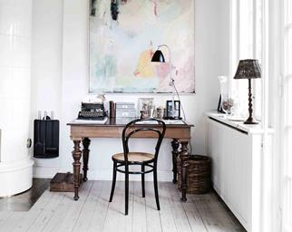 White room with a timber desk and chair