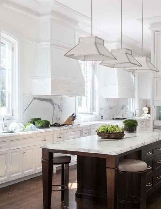 'Cassanova' chandeliers by Baker, Knapp & Tubbs in the kitchen.