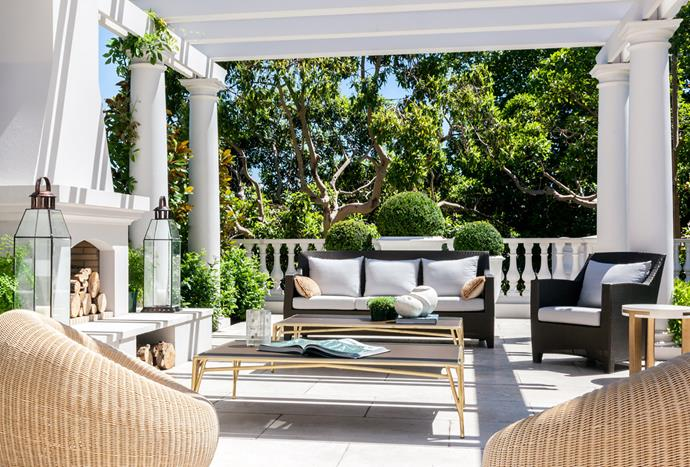 Bottom 'Barcelona' sofa and lounge chair on the pergola from Dedon, New York. 'Mulholland' coffee tables from Restoration Hardware, LA.