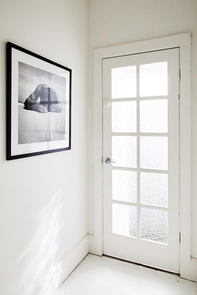 A print of Max Dupain's Sunbaker in the entry area is a fitting nod to the Bondi Beach locale.