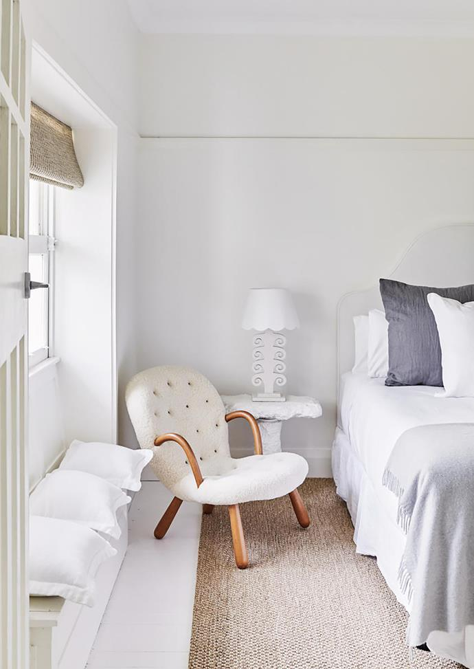 Plaster table lamp on a bedside table by Den Holm, 'Clam' armchair by Philip Arctander, and rattan mat from International Floorcoverings.