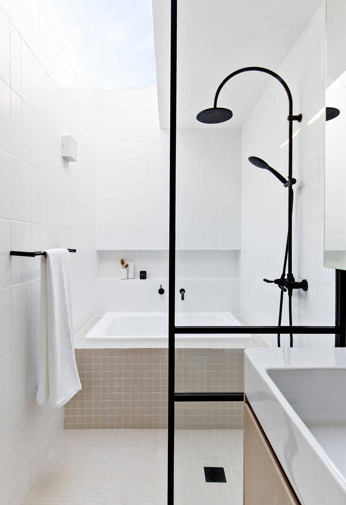 "**Main bathroom** ""Typical of a Japanese bathroom, the room is divided into wet and dry areas,"" says Kitty. ""The large skylight over the wet area draws the eye upwards rather than along the narrow space."" 'Hana' acrylic bath, [The Japanese Bath Company](https://www.japanesebath.com.au/