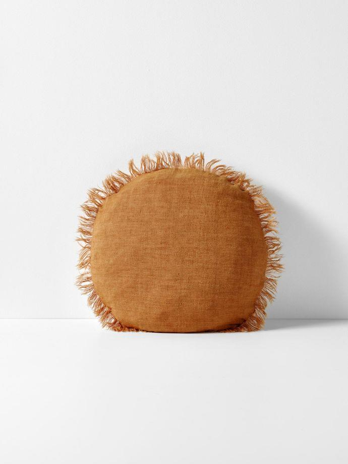 "Vintage Linen Fringe round cushion in Cinnamon, $69.95, [Aura Home](https://www.aurahome.com.au/vintage-linen-fringe-round-cushion-cinnamon|target=""_blank""|rel=""nofollow"")"