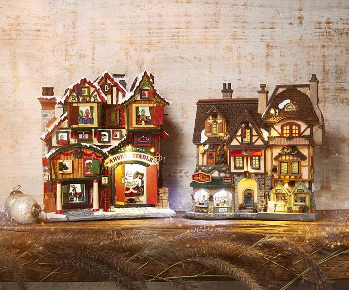 Two Christmas house ornaments on a shelf