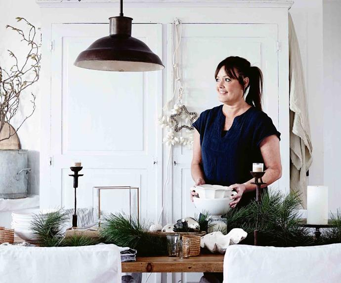 Woman setting Christmas table