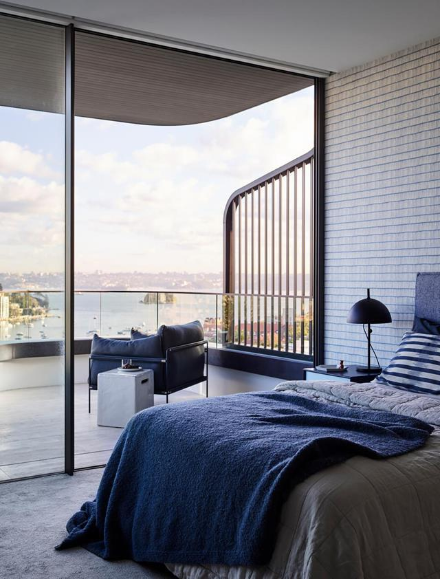 "With a dress-circle view of the harbour and the city,and quiet luxury reigning within, this [Sydney home](https://www.homestolove.com.au/elegant-family-home-with-show-stopping-views-20493|target=""_blank"") has all the attributes its owners were seeking. This bedroom sings with a calming blue and grey hues and features walls papered in Christopher Farr Cloth 'Crochet' from Ascraft."