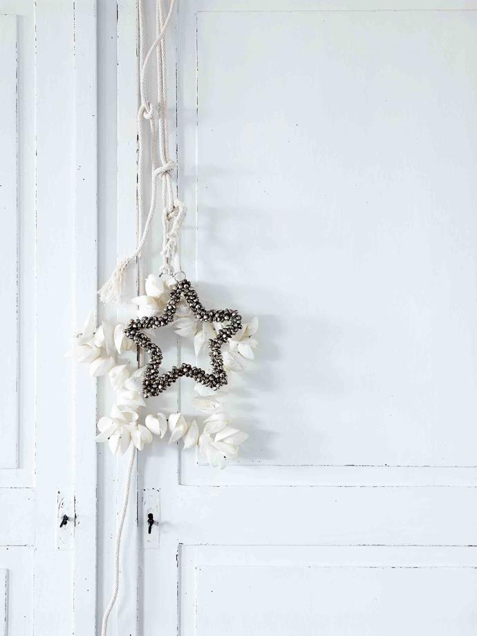 Handmade shell decorations hang from the armoire.