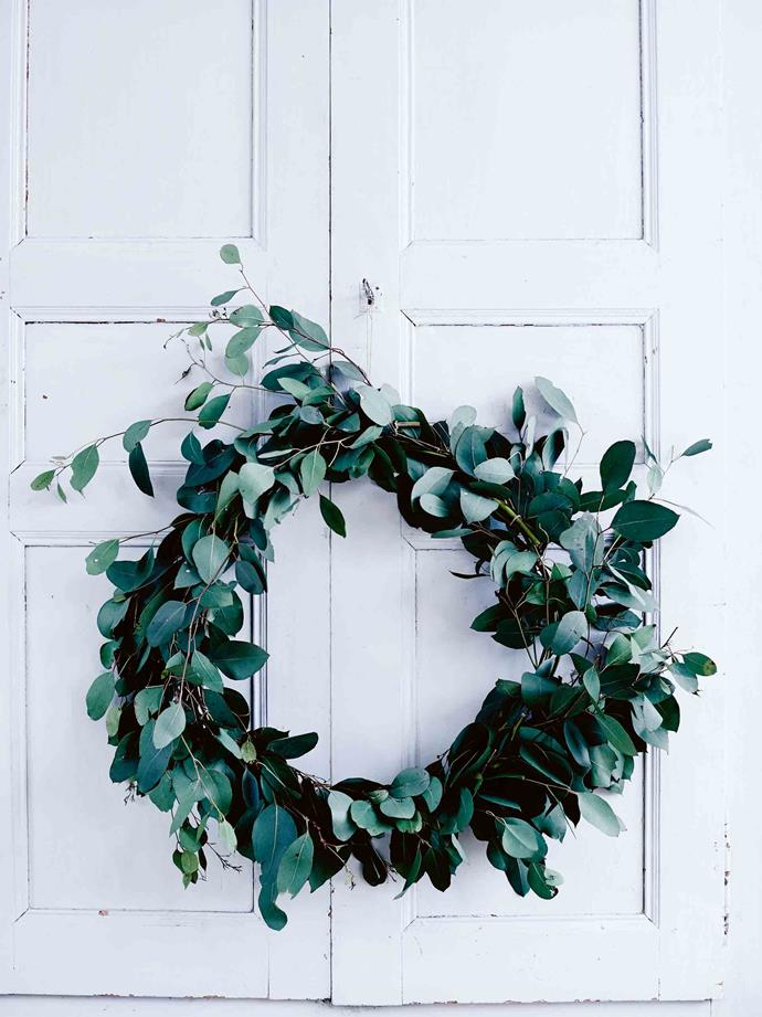 A wreath of eucalypt leaves hangs on the kitchen armoire.