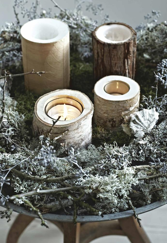 """A local spruce tree is left bare apart from its silver star, but the gifts are wrapped in white and black paper and ribbon. Branches are placed in vessels or twisted into [wreaths](https://www.homestolove.com.au/how-to-make-a-fresh-christmas-wreath-19489