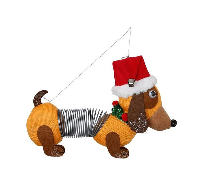"Heirloom brown fabric sausage dog with spring body, $17.99, from [Myer](https://www.myer.com.au/p/myer-giftorium-merry-bright-brown-fabric-sausage-dog-with-spring-body|target=""_blank""