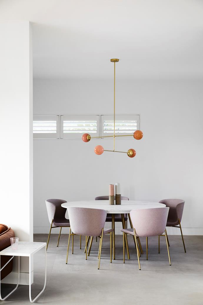 Well rounded The custom-made round dining table in this rejigged dining space by Sonja Kritzler Design allows for free-flowing dinner conversation, and Friends & Founders 'La Pipe' dining chairs from Fred International were selected for beauty and comfort.