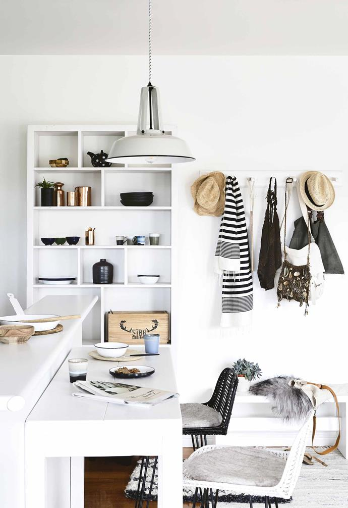 "**You seem fond of using white with black and grey?** <br><br>Completely! It's also the palette we use in our work. It works well because you never get tired of it and it's easy to live with. <br><br>**Kitchen** The kitchen island became more functional with the addition of a [House of Orange](https://www.houseoforange.com.au/|target=""_blank""