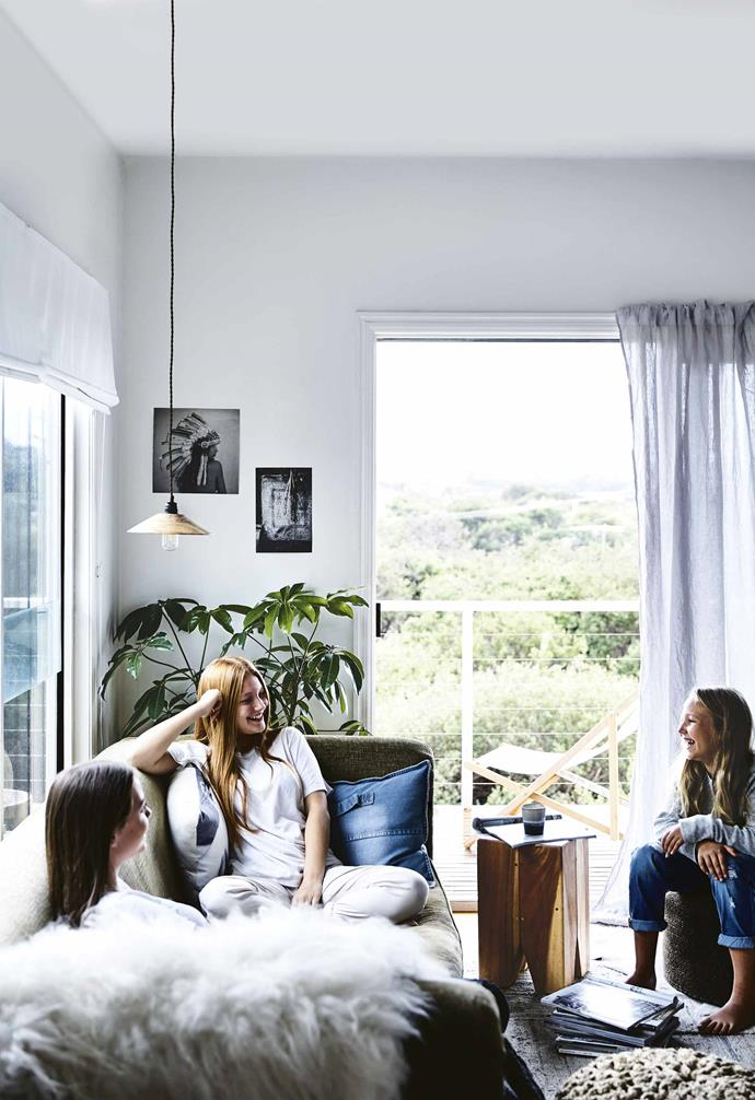 """**Are there any tricks to using white in an interior?** <br><br>A lot of people are scared to [layer white on white](https://www.homestolove.com.au/how-to-work-with-a-white-interior-5046 target=""""_blank""""), such as pairing white furniture with white walls. The key is getting the actual white tones right: they need to complement each other and be from the same 'family' of whites. And adding texture with [rattan](https://www.homestolove.com.au/how-to-introduce-rattan-furniture-at-home-5592 target=""""_blank""""), wood, a wall-hanging or a rug prevents a white scheme looking sterile.<br><br>**Living area** April, Nina and a friend enjoy expansive views over the treetops. [Norsu Interiors](https://norsu.com.au/ target=""""_blank"""" rel=""""nofollow"""") prints are a contemporary addition to this space."""