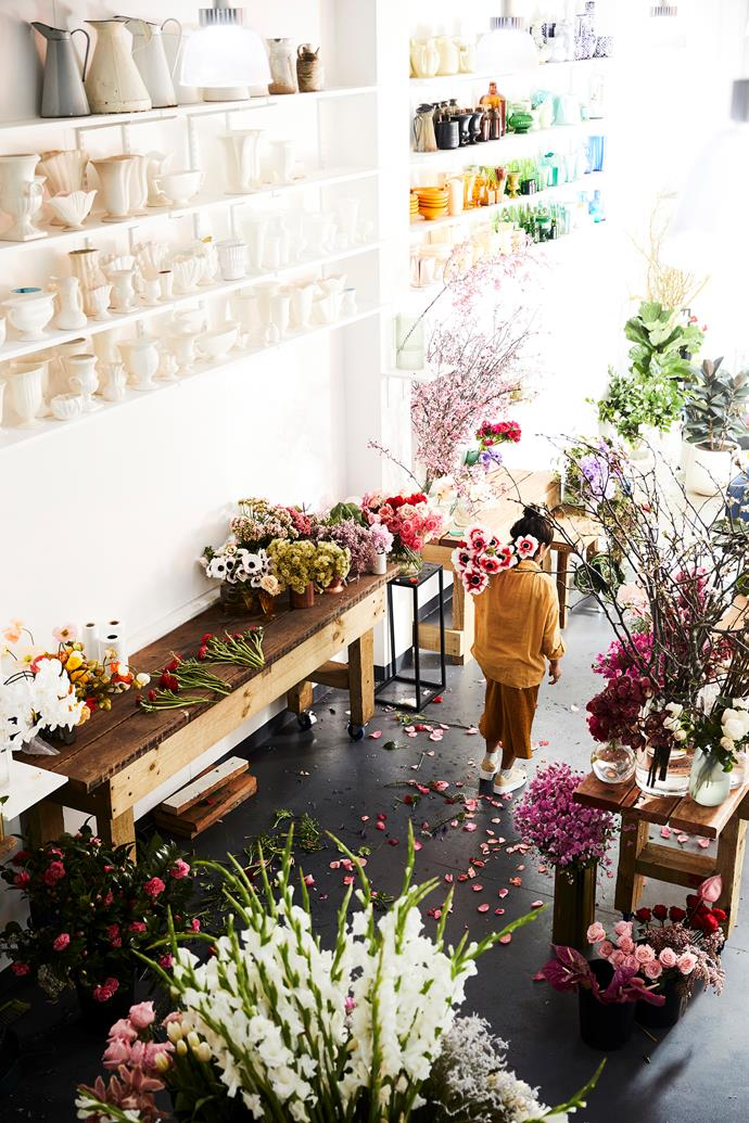 """Shelves lined with Myra Perez's collection of rainbow-hued vessels hover above breathtaking bunches of flowers. """"I won't ever sell them. They mean too much to me,"""" she says."""