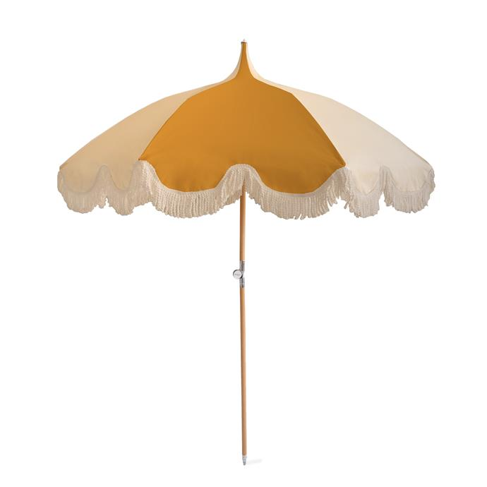 "Beach umbrella in Mustard & Cream, $389, [The Beach People](https://thebeachpeople.com.au/collections/beach-umbrellas/products/umbrella-mustard-cream|target=""_blank""