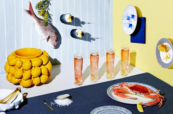 Brass tongs, $19.95, from The Lost and Found Department.  Vintage Murano highball glasses, $220 each, from Macleay on Manning. Ellen DeGeneres 'Cobalt Blue Chevron' side plate, $15.95, and dinner plate, $19.95, both from Royal Doulton. 'Ultima Thule' tumblers in Rain, $99.95/pair, from Iittala. Vintage blue liqueur shot glasses, $95/set of four, from Becker Minty. 'Pacific' side plate, $15.95, from Royal Doulton.