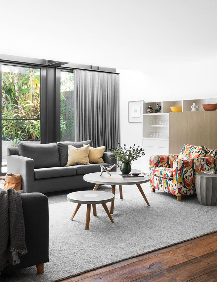 The owner's favourite armchair was reupholstered in a fabric she found; the vibrant colours energise the room. For similar fabric, try ReFindRetro. Coffee tables, Brad Wray Workshop. Sofa, Fanuli. Windows and doors from Schüco (throughout). Curtains in Warwick Fabrics 'Vanuatu Sheer' in Flint by Interior Solutions. Custom joinery. Custom rug by Armadillo & Co