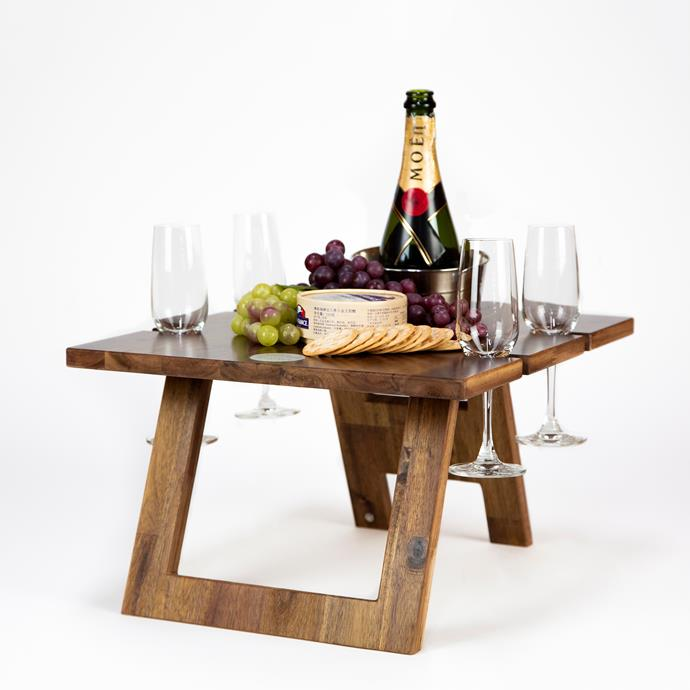 "'Honeymoon' Folding Wine Table (2 Glass) in Hardwood, $149.95, [Indi Tribe Collective](https://www.inditribecollective.com.au/collections/folding-wine-tables/products/folding-wine-table-4-glass-acacia|target=""_blank""