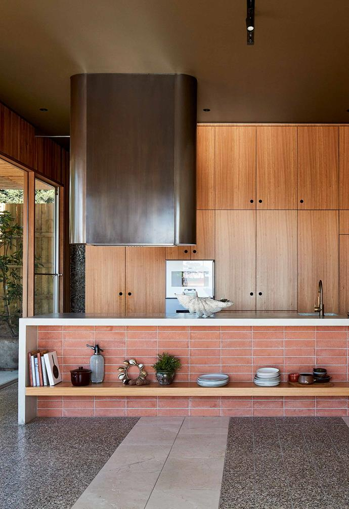 "**Kitchen** The kitchen sits in the new extension of the home and features a neutral palette of [terrazzo](https://www.homestolove.com.au/terrazzo-tiles-australia-15537|target=""_blank"") flooring, timber cabinetry, and a statement [kitchen island](https://www.homestolove.com.au/kitchen-inspiration-13-of-the-best-island-benches-17943