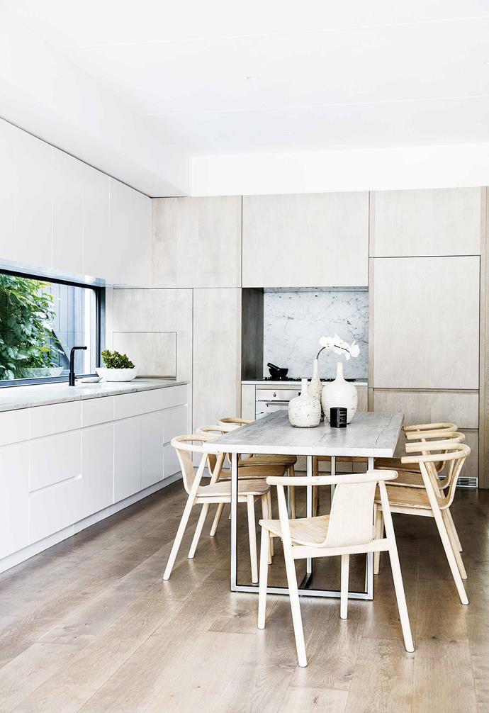 "This [Federation cottage in Queens Park](https://www.homestolove.com.au/federation-cottage-queens-park-18311|target=""_blank"") has ensconced their dining table into their compact kitchen space. A mix of timber tones helps give a streamlined visual impression."