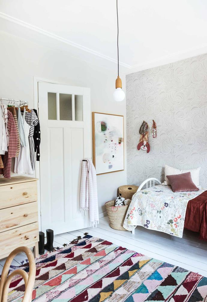 "**Lola's bedroom** In this room there is more colour, largely thanks to a vintage Moroccan boucherouite rug. ""I bought it years ago and I've always loved it, it's so fun and playful,"" says Holly. A large artwork by Lola Donoghue also amps up the vibrancy."